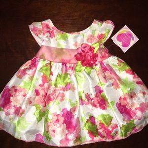 Beautiful dress NWT 12 mo.